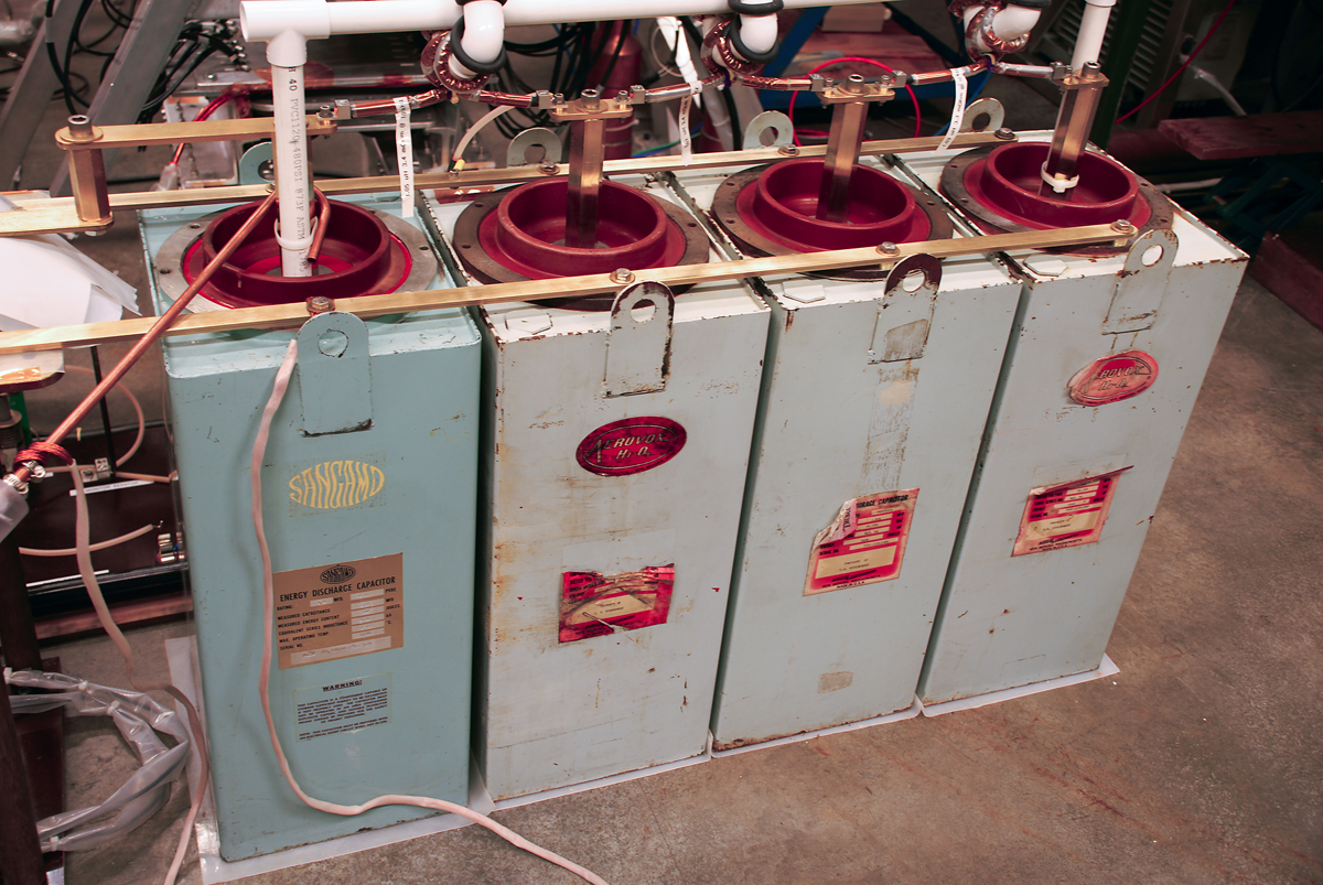 Four capacitors supply up to 10,000 volts to separate the xenon electrons from their nuclei, creating an electrically charged plasma.
