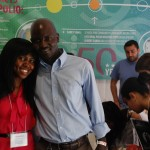 UW Environmental Health student Tolu Okitika of Nigeria and UW master's of public health graduate and CNN Hero Peter Kithene of Kenya at the Pathways to Global Health exhibit