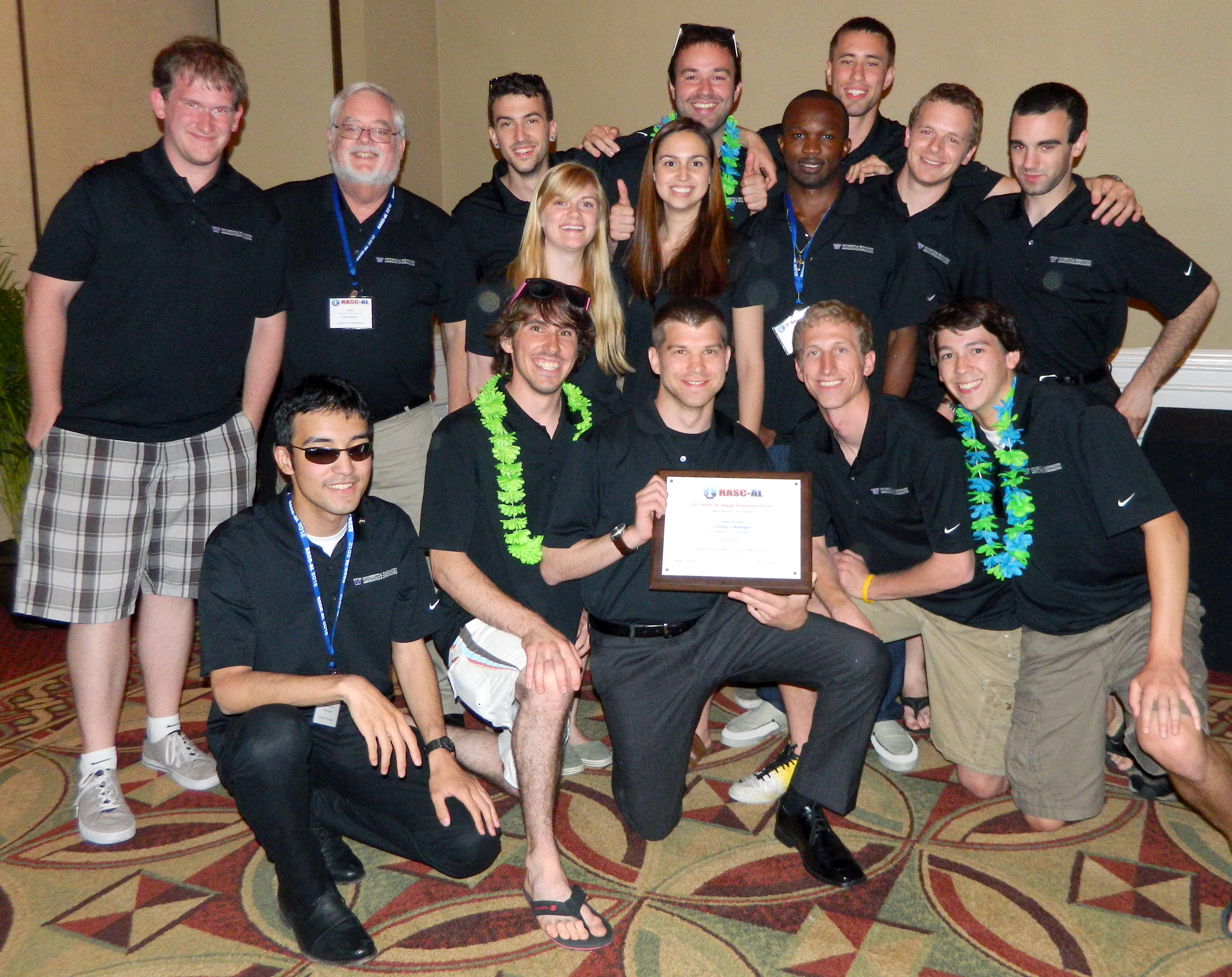 Thirteen UW seniors traveled to Florida for the contest. Standing on the left are teaching assistant Mike Hughes, a UW graduate student in aeronautics and astronautics, and instructor Dana Andrews.