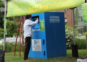 Student donates clothing at a collection site outside Terry Hall