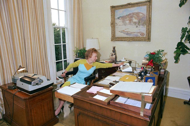 Rose Mary Woods, Richard Nixon's secretary, demonstrating what came to be called the Rose Mary Stretch.
