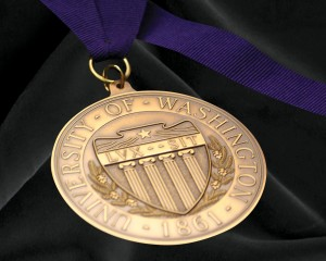 Golden medal for awards of excellence on purple ribbon