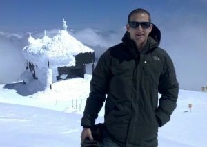 David Smith stand in front of the snow encrusted building housing the Mt. Bachelor oberservatory