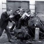 A guard takes cover behind dead horses in 1936 during the Spanish Civil War.