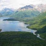 Mountains surround lake, stream in Alaska