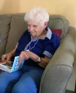 A healthy woman, about to turn 94, enjoys a family album. UW researchers are working to reduce the effects of aging and diseases of old age.
