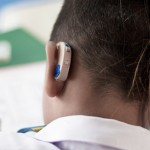 Student wears hearing aid in class