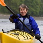 Sally Jewell paddles a kayak.
