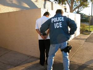 An Immigration and Customs Enforcement arrests a suspect.