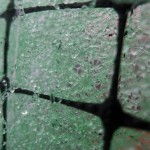 Close up of water drops on green matting