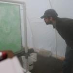 Facutly members examines creen of green matting in haze of fog