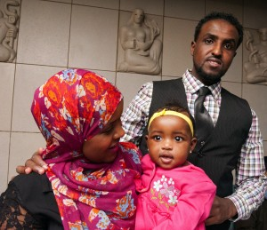 Graduating medical student Anisa Ibrahim, at Match Day with her husband and baby daughter, will train as a pediatrician.