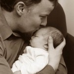 father holds infant