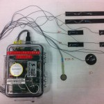 A photo of the portable device and electrodes