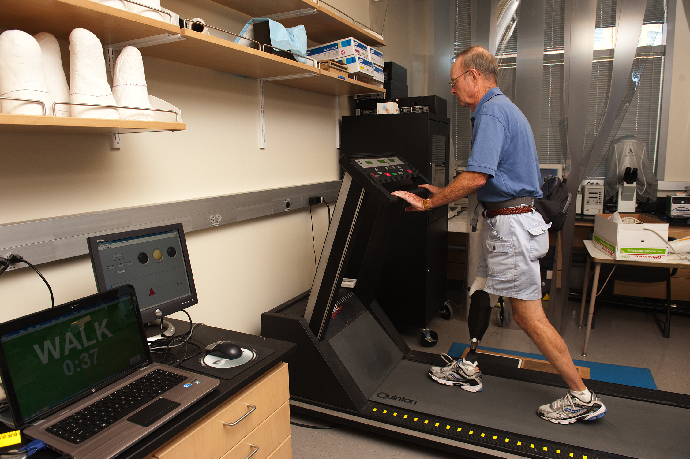 Ron Bailey walks on the treadmill during the testing regimen.