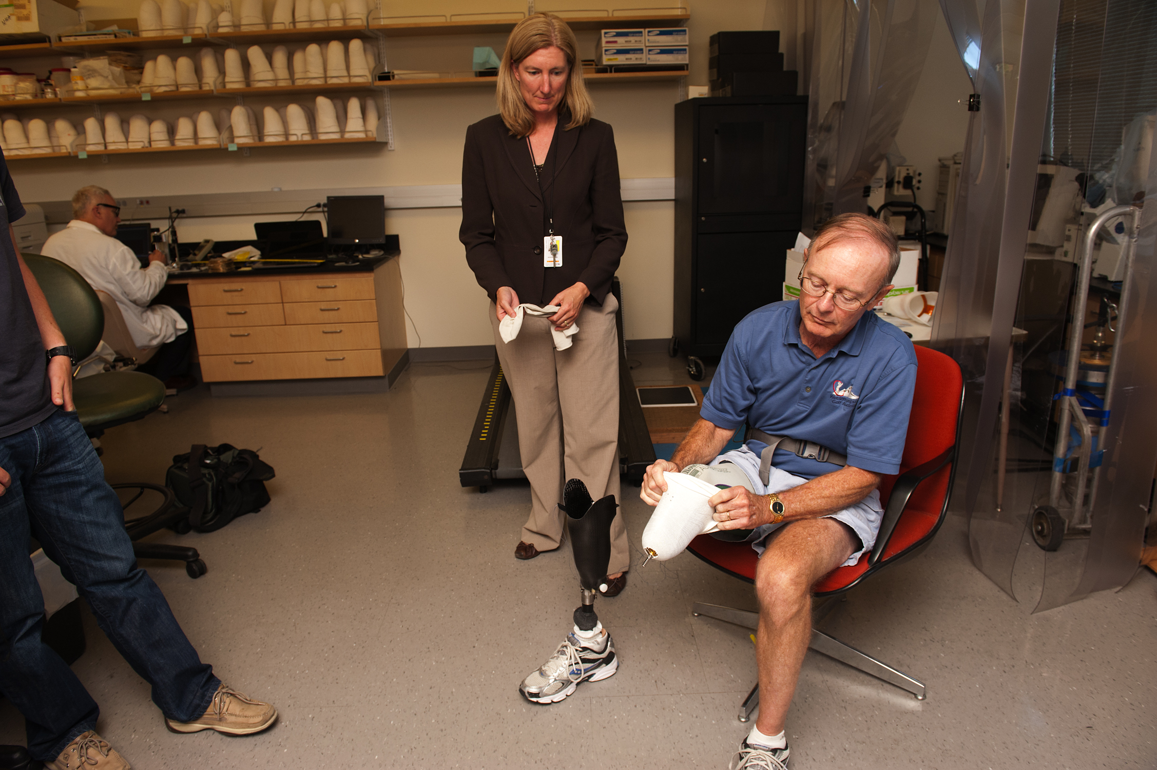 Ron Bailey puts on his prosthetic leg.