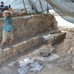 UW classics alumnus Kyle Vormestrand prepares to sledge a large ashlar, or wall block, for removal. In the background, David Armo, a UW anthropolgy alumnus, works as the area recorder, cataloging all artifacts at the UW's Tel Dor archaeological site.