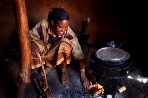 A woman cooking over a more efficient cookstove