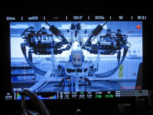 "A close-up shoot of the UW's Raven II robot as it simulates brain surgery on actor Moisés Arias during the filming of ""Ender's Game."""