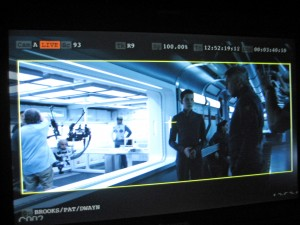 "At right, actors Asa Butterfield and Harrison Ford during the filming of a scene from ""Ender's Game."" The UW robot can be seen on the left."