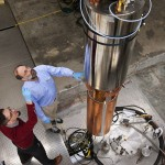 Physicists examine components of the axion detector at the University of Washington.