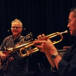 men play guitar and trumpet