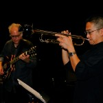 Men playing guitar and trumpet