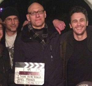 "The cast and crew of ""I Think You're Totally Wrong: A Quarrel,"" a film directed by James Franco of a forthcoming book by David Shields and Caleb Powell. Shields is at center, holding the clapboard. Franco is to his right, Powell at his left."