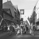 A black and white photo of a Baltica Folklore Festival procession in Riga, Latvia in July 1988.
