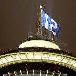 "A Seattle Seahawks ""12th man"" flag, representing the fans, flies over the Space Needle."