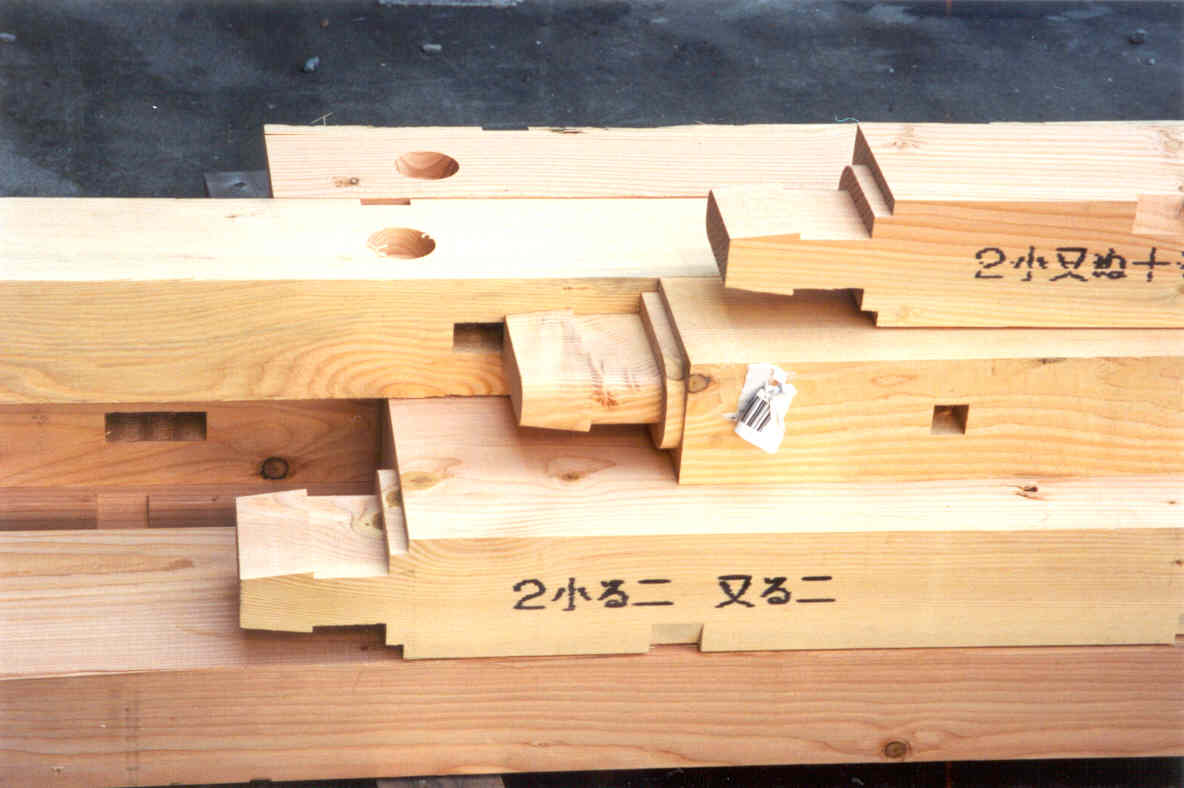 eight boards with special notched ends for post-and-beam construction
