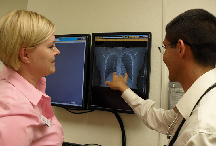 UW Dr. Hollie Matthews works with student David Lepez in Moses Lake in 2010.
