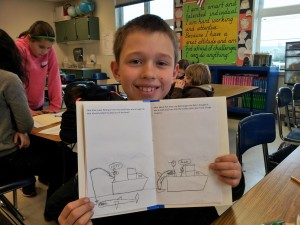 A student at Long Beach Elementary shows off the book he wrote in 2013.