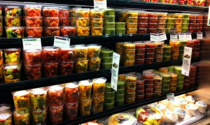 a refrigerator section at a grocery store containing fruit