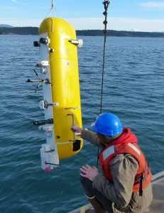 researcher with instrument at sea