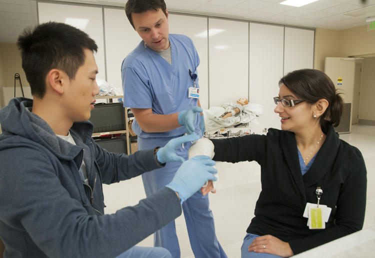 University of Washington medical students practice placing casts.