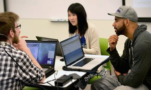 University of Washington graduate students talk about their projects in class.