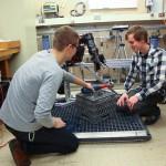 Undergraduates students work on instrumentation with the BluHaptics team.