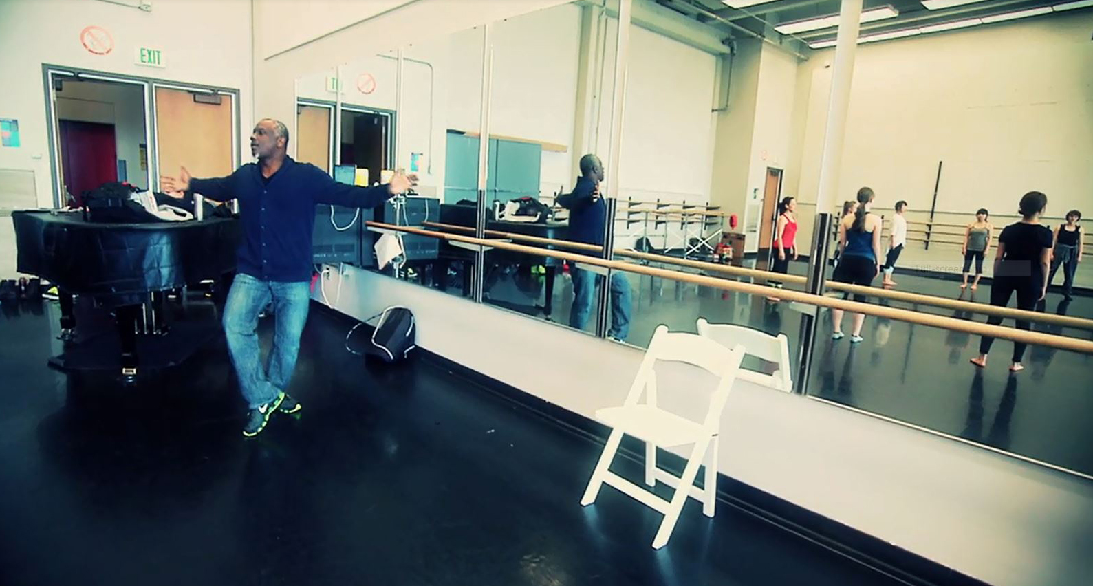 Choreographer Robert Moses works with dancers in a recent rehearsal at the University of Washington.