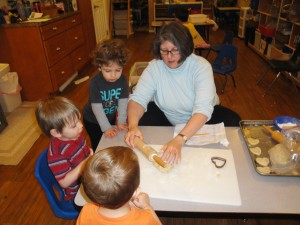 Anita McHarg makes cookies with toddlers.