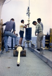 people placing corer on boat