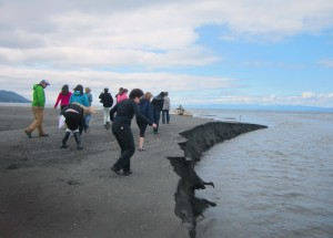 students walking on sand