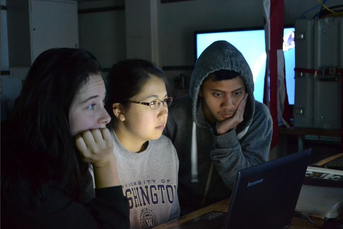 students watching screen