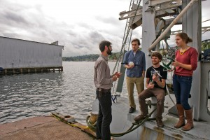 researchers standing on boat