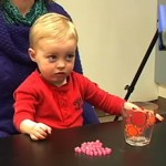 "A toddler reacts after an adult has expressed ""annoyance"" at the behavior of another adult."