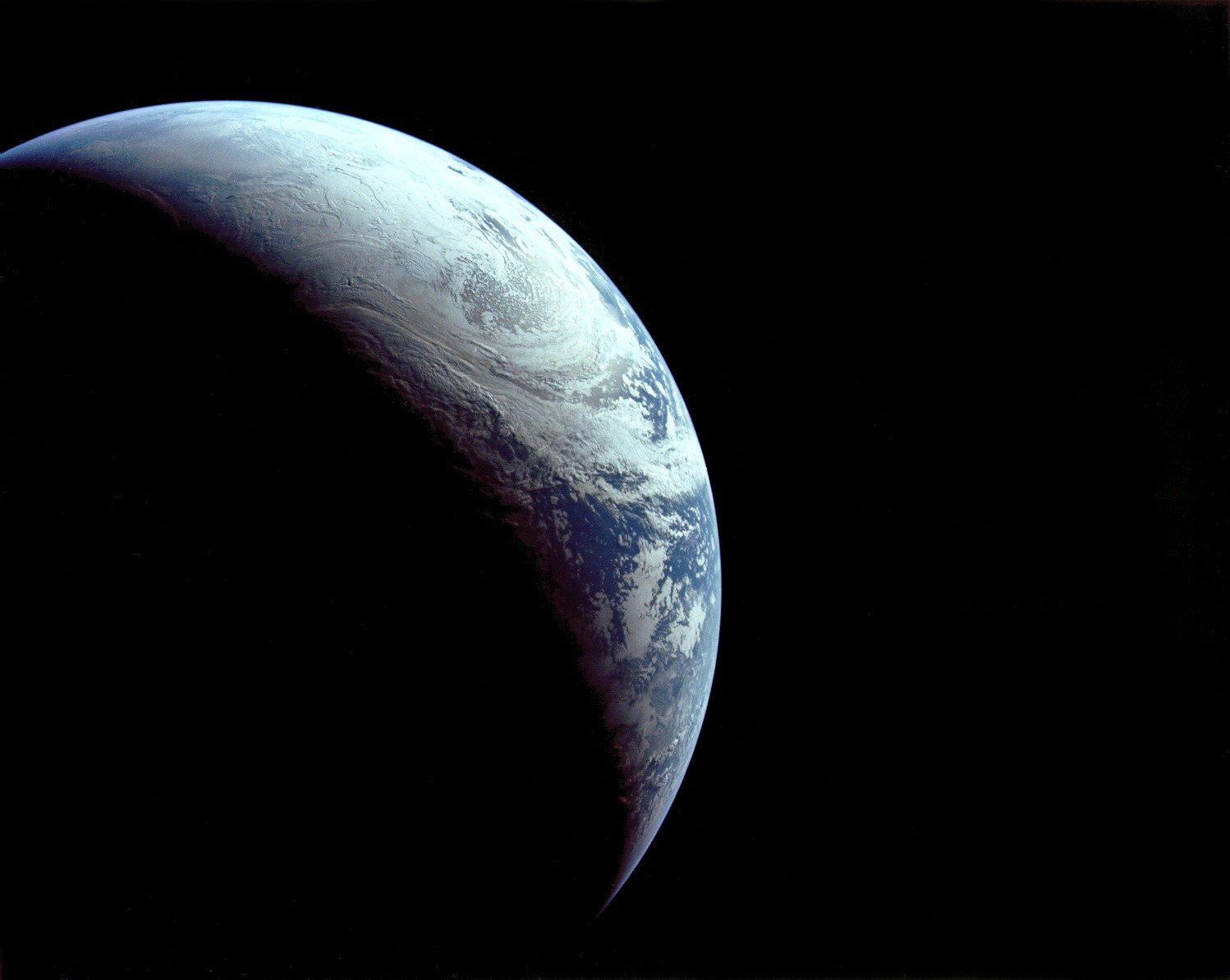 The Earth as seen by the crew of Apollo 4 from about 10 miles up. University of Washington astronomer Woody Sullivan and co-author ask, have there been other species with energy-intensive technology? And if so, how long did they last?
