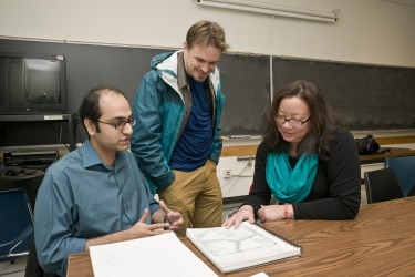 Doctoral student Ahmer Arif, left, gets feedback from co-instructors Jeremy Kayes and Charlotte Lee.