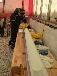 photo of person in tent bending over ice core