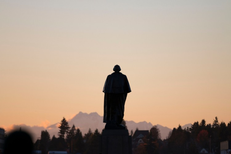 Silhouette of George Washington statue, University of Washington, Seattle campus on November 20th, 2013. Photo by Katherine B. Turner