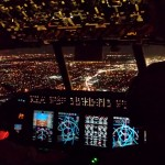 view of city lights out cockpit window